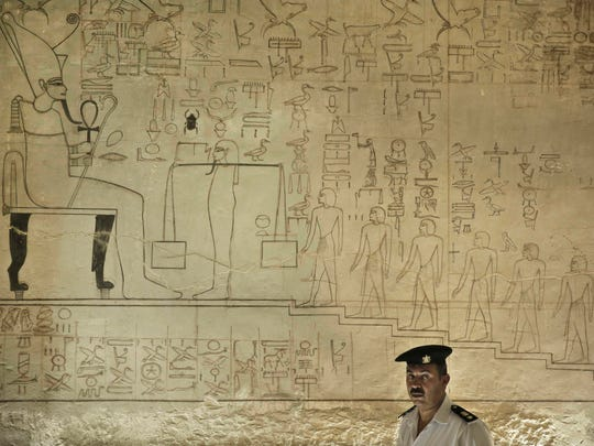 A policeman stands guard at the Horemheb tomb in the