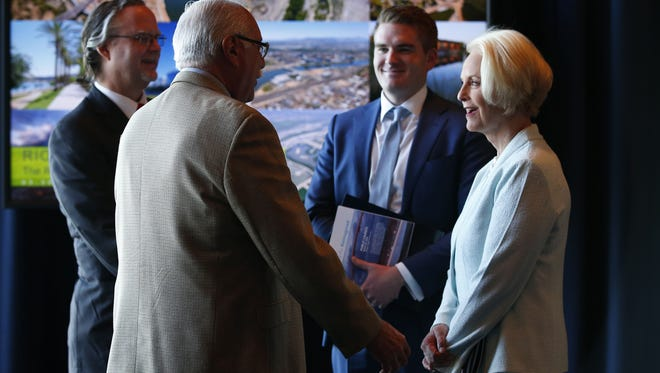 Former U.S. Representative Ed Pastor talks with Cindy McCain during the Rio Reimagined meeting at the Tempe Center for the Arts on March 30, 2018.