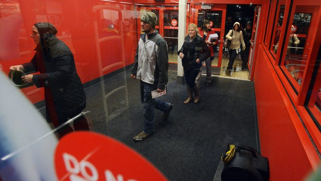 Customers file into the Target store on Louise shortly after opening at 6PM on Thanksgiving night, Nov 26, 2015.