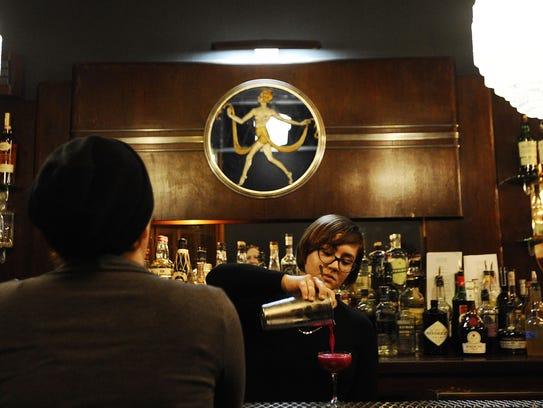 Antietam bartender Taylor Schmidt mixes a drink under