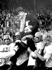 Oregon State head coach Tommy Prothro gets a ride from Beaver players after winning the 1957 Civil War football game against University of Oregon, 10-7.