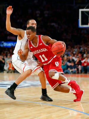 Yogi Ferrell (11) and Shabazz Napier both had great games as UConn edged Indiana 59-58.