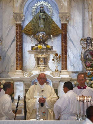 Pope Francis gives mass at the basilica to Our Lady of Charity of El Cobre, the patron saint of Cuba -- a mixed-race Mary that symbolizes the island's intertwined Spanish and African roots in the village of El Cobre, Santiago de Cuba, on September 22, 2015.