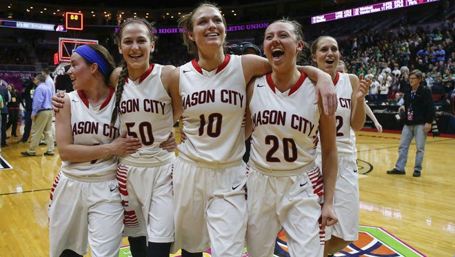 Members of the Mason City girls basketball team celebrate a Class 4A state championship after beating Pella at Wells Fargo Arena in Des Moines on Saturday, March 5, 2016.