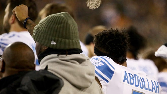 Detroit Lions' Ameer Abdullah raises his fist during the playing of the national anthem before the game against the Green Bay Packers at Lambeau Field on Nov. 6, 2017.