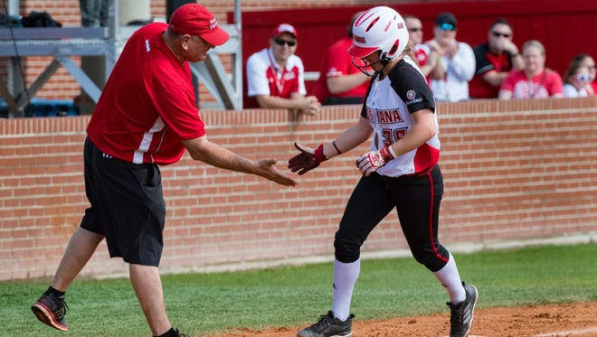 UL's Kara Gremillion slaps the hand of head coach Gerry Glasco after hitting a solo home run in game of of Saturday's doubleheader sweep of Appalachian State at Lamson Park.