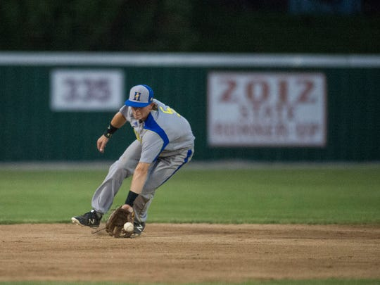 Henderson's Clayton Mehlbauer fields a grounder during