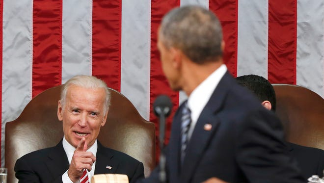 Vice President Biden points at President Obama during the president's State of the Union address to a joint session of Congress Jan. 12. Obama is creating a new federal task force to accelerate cancer research.