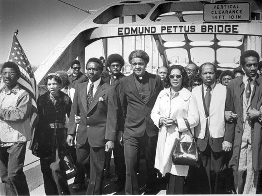 The Rev. James Robinson escorts Coretta Scott King