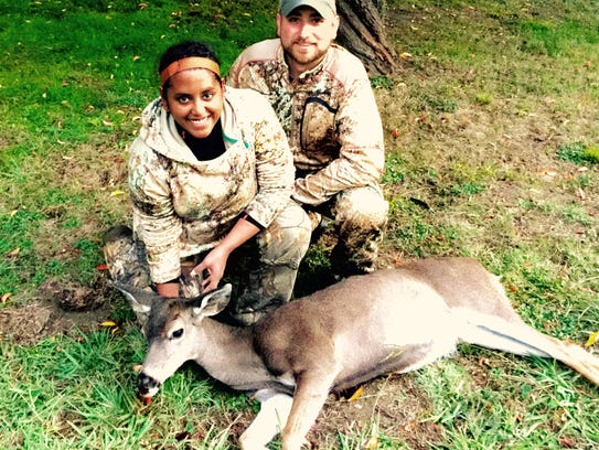 Dominic and Asha Aiello with Asha's first blacktail