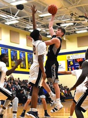 West Clermont's John Aicholtz pops up a jump hook for