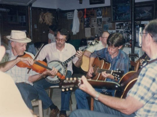 Grover, Jerry and Bryan Sutton, three generations of the family, play at a long-ago session at Mrs. Hyatt's Music House.