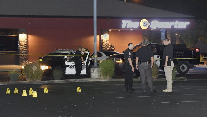 Four people in an SUV were leaving The 5th Quarter bar and restaurant when a man fired multiple times into the vehicle injuring all four, one seriously.