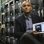 In this Dec. 20, 2012, file photo, Chet Kanojia, founder and CEO of Aereo, Inc., shows a tablet displaying his company's technology, in New York. Aereo is one of several startups created to deliver traditional media over the Internet without licensing agreements. (AP Photo/Bebeto Matthews, File) ORG XMIT: NYBZ204