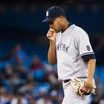 New York Yankees pitcher Ivan Nova (47) reacts after allowing runs against the Toronto Blue Jays during eighth inning AL baseball action in Toronto on Wednesday, April 13, 2016.