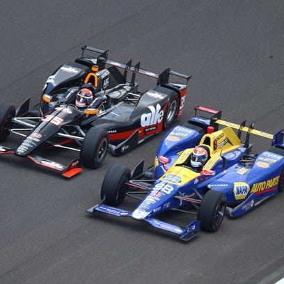 IndyCar Series driver Alexander Rossi (right) drives alongside Alex Tagliani on Sunday during the 100th running of the Indianapolis 500 at Indianapolis Motor Speedway.