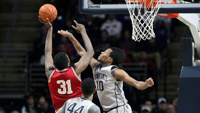 Penn State Nittany Lions forward Brandon Taylor (10) defends as Indiana Hoosiers center Thomas Bryant (31) attempts a shot during the first half at Bryce Jordan Center. Penn State defeated Indiana 68-63.