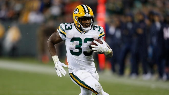 Green Bay Packers' Aaron Jones runs during the second half of an NFL football game against the Chicago Bears Thursday, Sept. 28, 2017, in Green Bay, Wis. (AP Photo/Matt Ludtke)