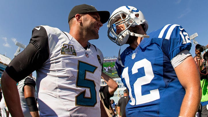 JACKSONVILLE, FL - SEPTEMBER 21: Andrew Luck #12 of the Indianapolis Colts talks with Blake Bortles #5 of the Jacksonville Jaguars after the game at EverBank Field on September 21, 2014 in Jacksonville, Florida.  (Photo by Rob Foldy/Getty Images)