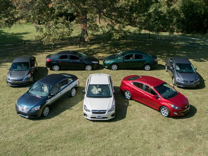 Contenders in the $20,000 Compact Car Challenge (clockwise from left): 2014 Kia Forte LX, 2014 Ford Focus S, 2014 Toyota Corolla LE Eco, 2013 Honda Civic LX, 2013 Hyundai Elantra GLS, 2013 Subaru Impreza 2.0i and 2013 Nissan Sentra SV