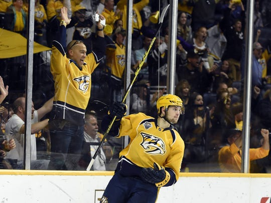 Predators center Filip Forsberg (9) celebrates a goal