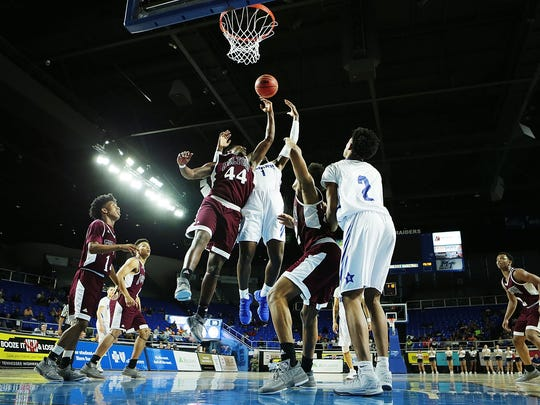 Martrell Brooks(1) from Hamilton High School shoots over Knoxville Fulton's Deshaun Page 44) during their AA championship game on March 17, 2018 at the Murphy Center Complex in Murfreesboro.