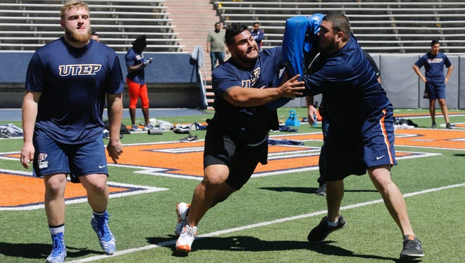 UTEP's Will Hernandez goes through lineman drills during UTEP's Pro Day on March 20, 2018, at the Sun Bowl in El Paso, Texas. Fellow Miner Derek Elmendorff holds the pads for Hernandez. Hernandez is expected to be a first- or second-round pick in the 2018 NFL Draft.