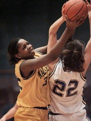 Nazareth's Rochelle Cherry, left, tries to pull this rebound away from Marcus Whitman's Christine Graham in this file photo from March 9, 1998.