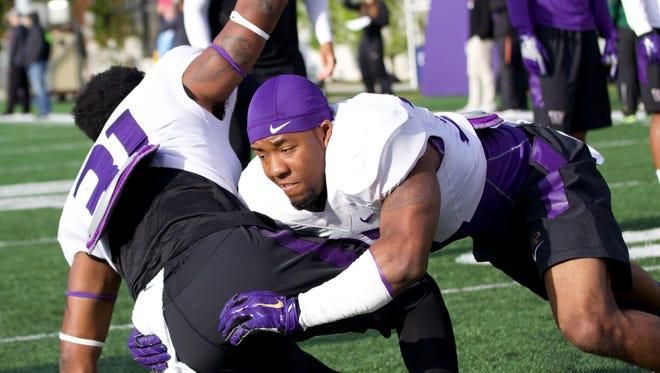 Washington defensive back Budda Baker takes down a teammate in a rugby tackling drill at a recent Washington practice.
