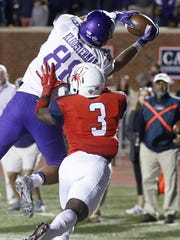 James Madison's Jonathan Kloosterman snags a touchdown pass next to the University of Richmond's Tafon Mainsah in the second half of an NCAA college football game earlier this season. JMU defeated UR 47-43.