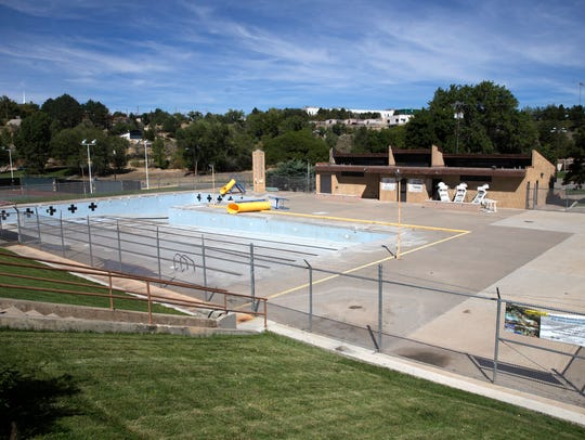 Farmington's empty Brookside Pool, which will be replaced by a new water park, is seen on Sept. 19. Officials can't agree yet on what to name the new facility.