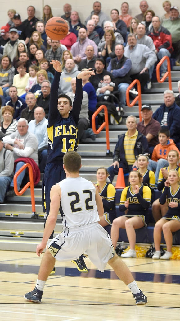 Elco's Masson Bossert launches a three point shot that proved critical in closing the gap against a Knight lead. Eastern York boys basketball squeeked past Elco 64-63 at Hershey High School, Friday, Feb. 19.
