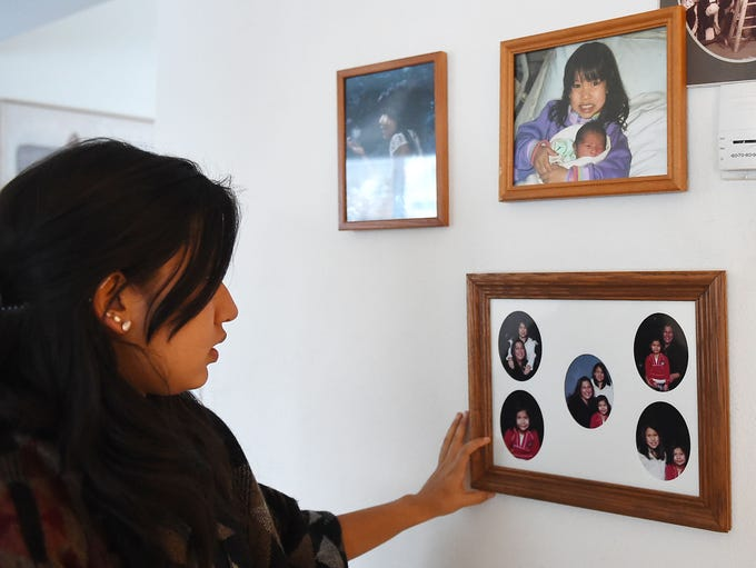Bella Cordova, 16, points out family photos with her