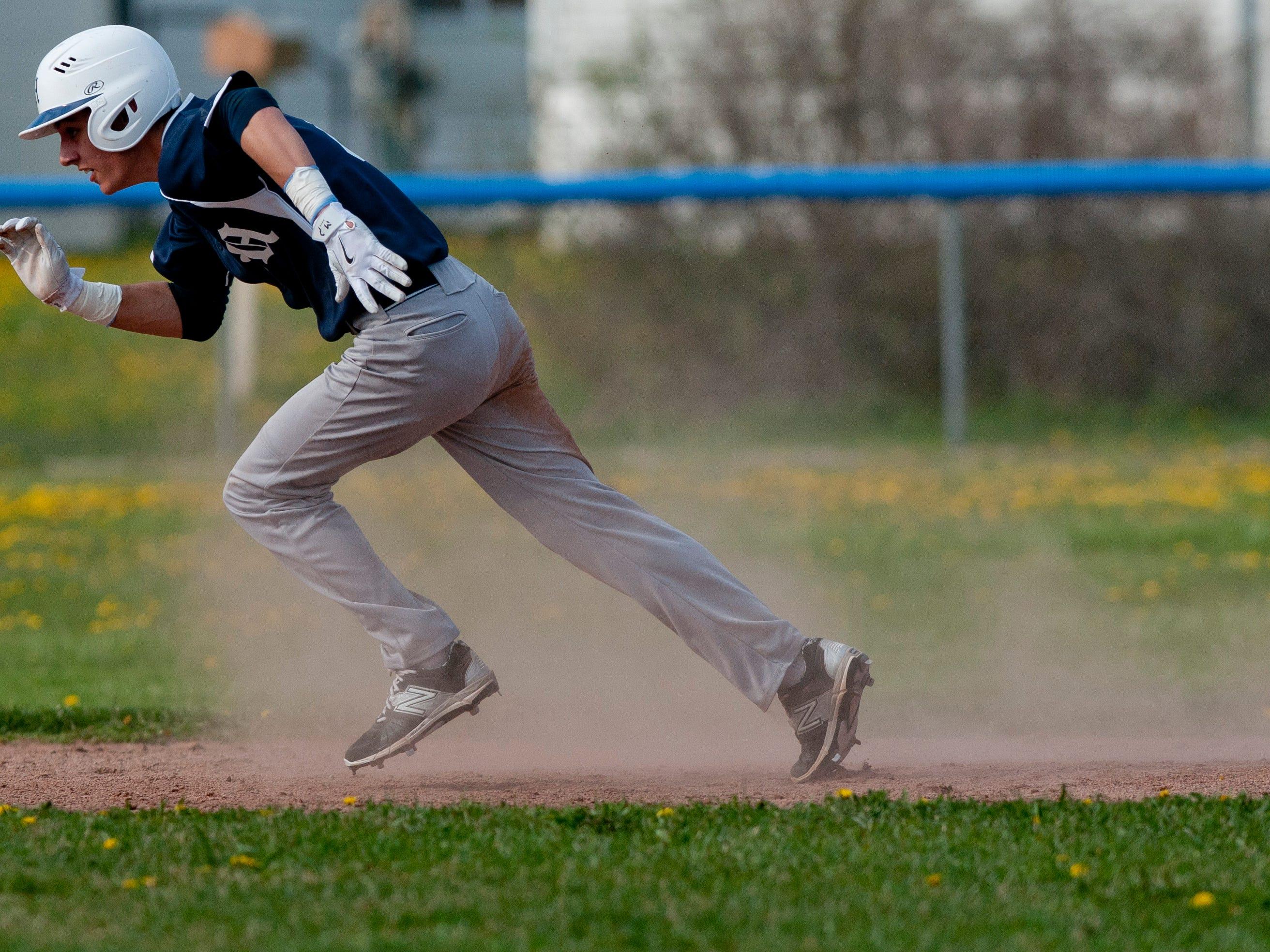 Marysville's Joe Koch runs for third during a baseball game Wednesday, May 6, 2015 at St. Clair High School.