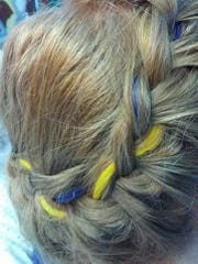"Hill's mom Lisa posted to Facebok Sunday and said she added ""a splash"" of blue and gold to Hill's hair."