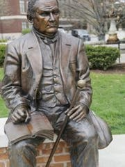 A statue of John Purdue just a few yards from Purdue's grave Thursday, April 16, 2015, in the Purdue Memorial Mall on the campus of Purdue University.