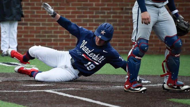 Vanderbilt left fielder Stephen Scott (19) slides into home to score a run during their game against Mississippi at Hawkins Field Sunday, April 15, 2018, in Nashville, Tenn.