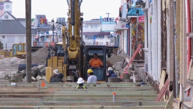 Workers replace several blocks of boardwalk in Ocean City, N.J. The work is being done in December to avoid disrupting the spring and summer beach seasons.