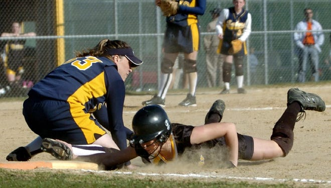 Susquehanna Valley's Shannon Pease, left, who will be one of the 7th Susquehanna Valley Wall of Fame inductees Saturday, in 2005 at a game  in Windsor. Windsor's Jenna Waldron, right, slides back into first base just before the tag from. Wiggins was called out.