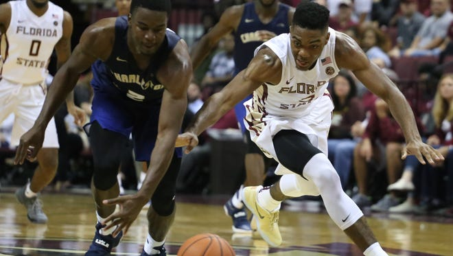 Trent Forrest (3) dives for a loose ball during Florida State's 88-67 win over Charleston Southern.