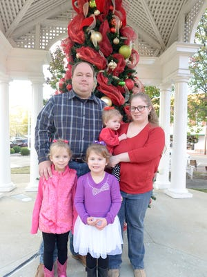 Blake and Stephanie Gilbert stand with their daughters, 6-year-old Audrey, 5-year-old Savannah, and 23-month-old Abby. Abby is now on the road to recovery from her battle with acute respiratory distress syndrome.