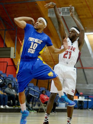 Lane College's Malcom McDonald pulls up for a 3-pointer over a Fort Valley State defender during their game Saturday.