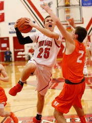 Blake Bennington of Twin Lakes puts up a shot while guarded by Camyn Lutz of Hamilton in the semifinals of the Hoosier Conference tournament Friday, February 19, 2016, at Twin Lakes High School. Hamilton Heights defeated Twin Lakes 66-51.