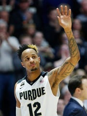 Senior Vincent Edwards waves to the Purdue faithful as he comes out of the game late against Minnesota on Sunday, Feb. 25 2018, at Mackey Arena.