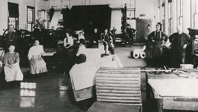 This photograph, circa 1909, shows the finishing room of Gilbert Paper Company.