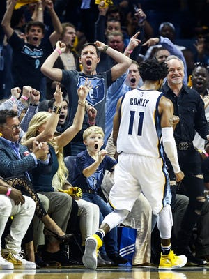 Grizzlies fans celebrate guard Mike Conley's 3-pointer in Game 4 on Saturday.