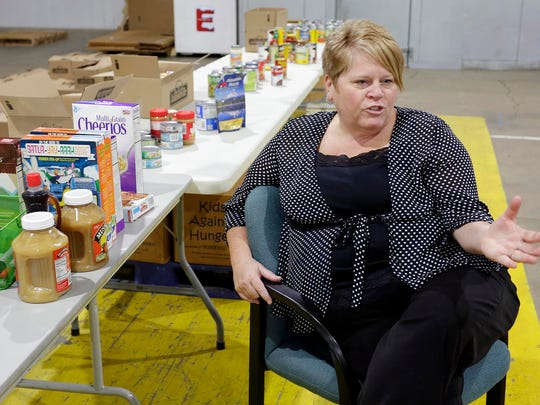 Liz Kroll, executive director of the Sheboygan County Foodbank talks about her organization at their new facility Wednesday November 9, 2016 in Sheboygan.