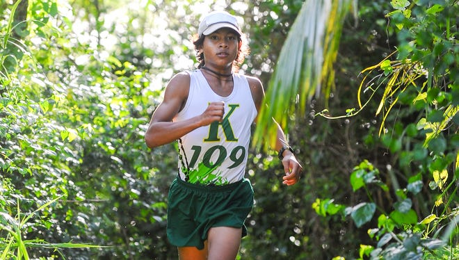 Runners of the St. John's Knights and John F. Kennedy Islanders cross country teams laced up their shoes and competed against each other during the Independent Interscholastic Athletic Association of Guam Cross-Country League meet at John F. Kennedy High School in Tamuning on Monday, Sept. 21.
