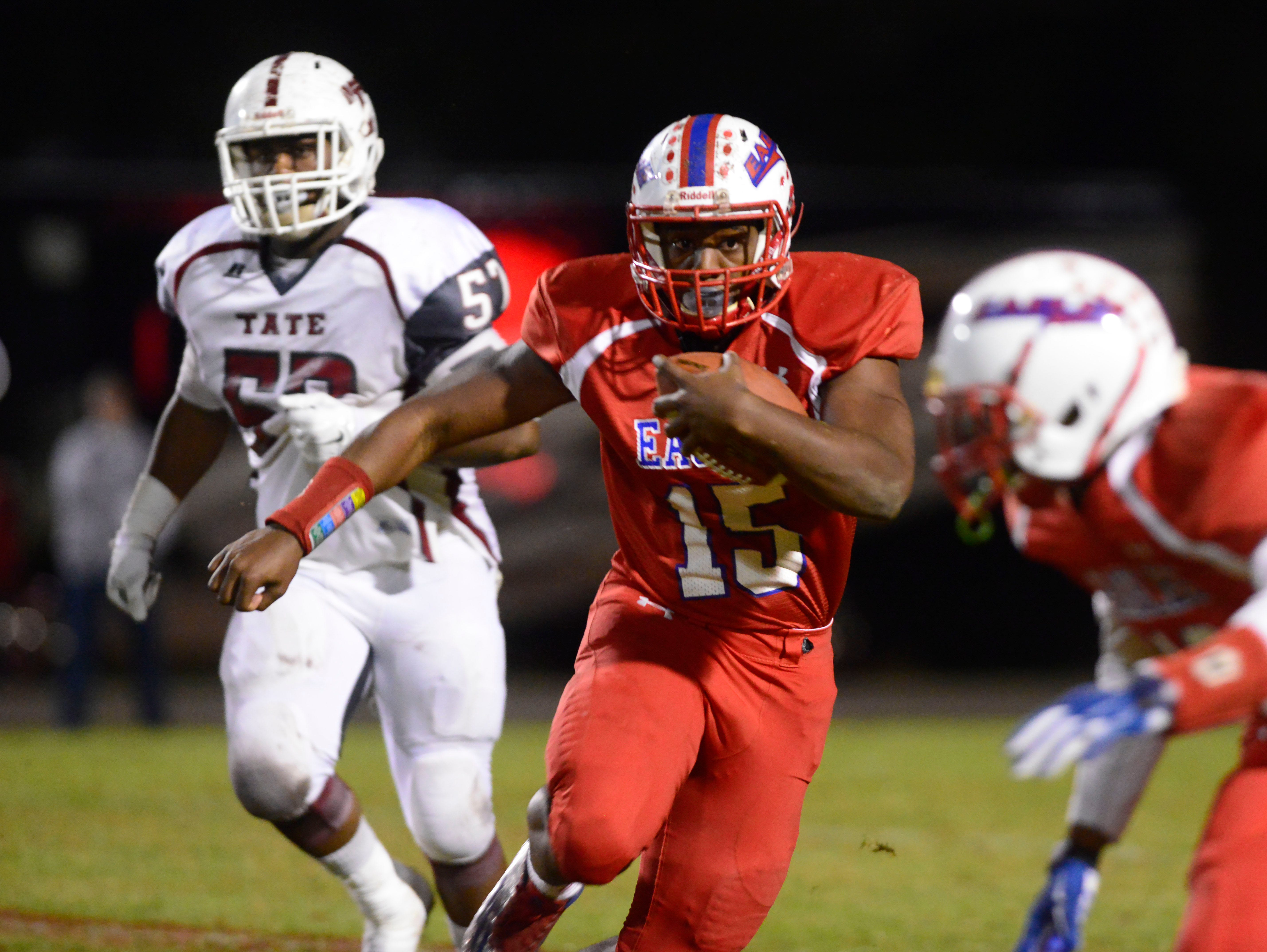 Pine Forest High School quarterback Xavier Saulsberry looks for a clean running path Friday night in the Region 1-6A final against Tate. Tate beat Pine Forest 31-7.