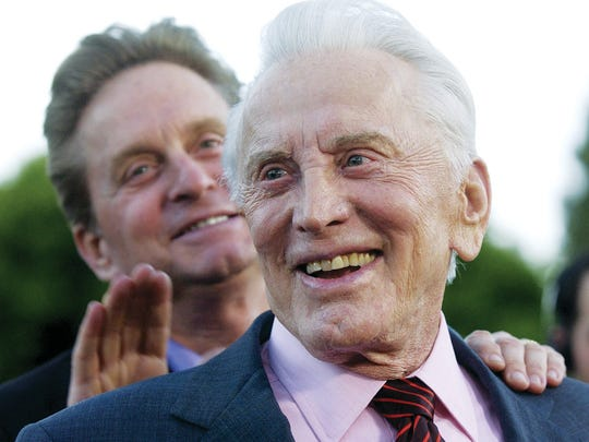 """Kirk Douglas, front, and his son, Michael, stars of ""It Runs in the Family,"" arrive at a special screening of the film in the Westwood section of Los Angeles, Monday, April 7, 2003. (AP Photo/Chris Pizzello)"""